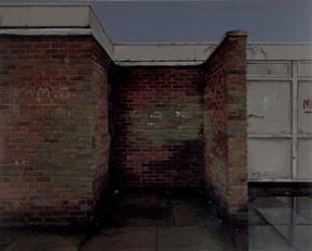 A dingy corner between brick walls