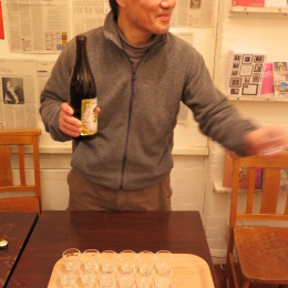 Isao Miura serves sake at the Haibun Evening, The Poetry Café, 23 March 2015.