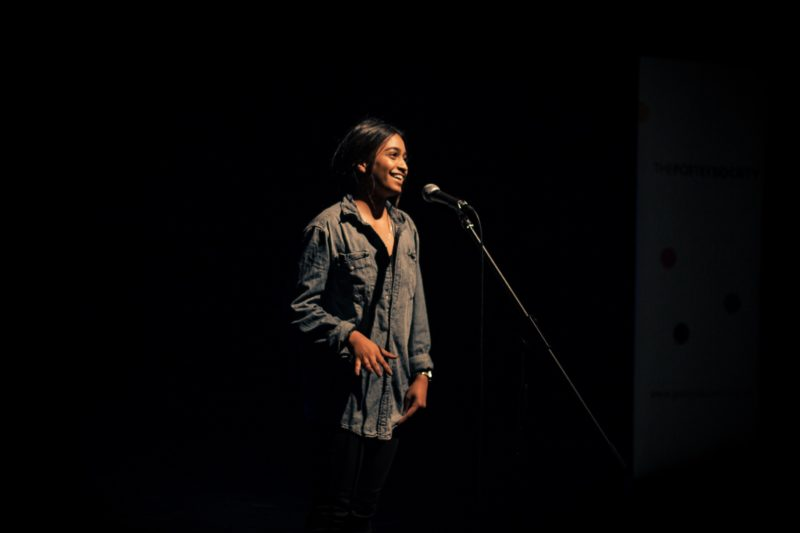 a student performs at a SLAMbassadors showcase