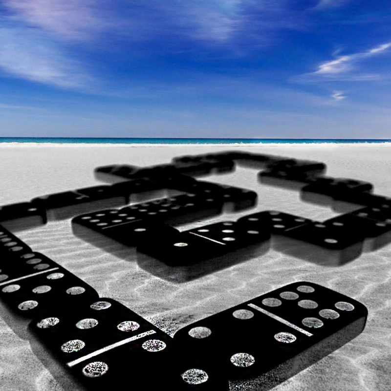 Dominoes and a sandy beach