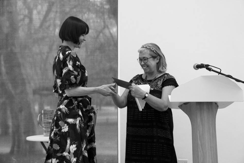 Sarah Westcott receives her award from Pascale Petit