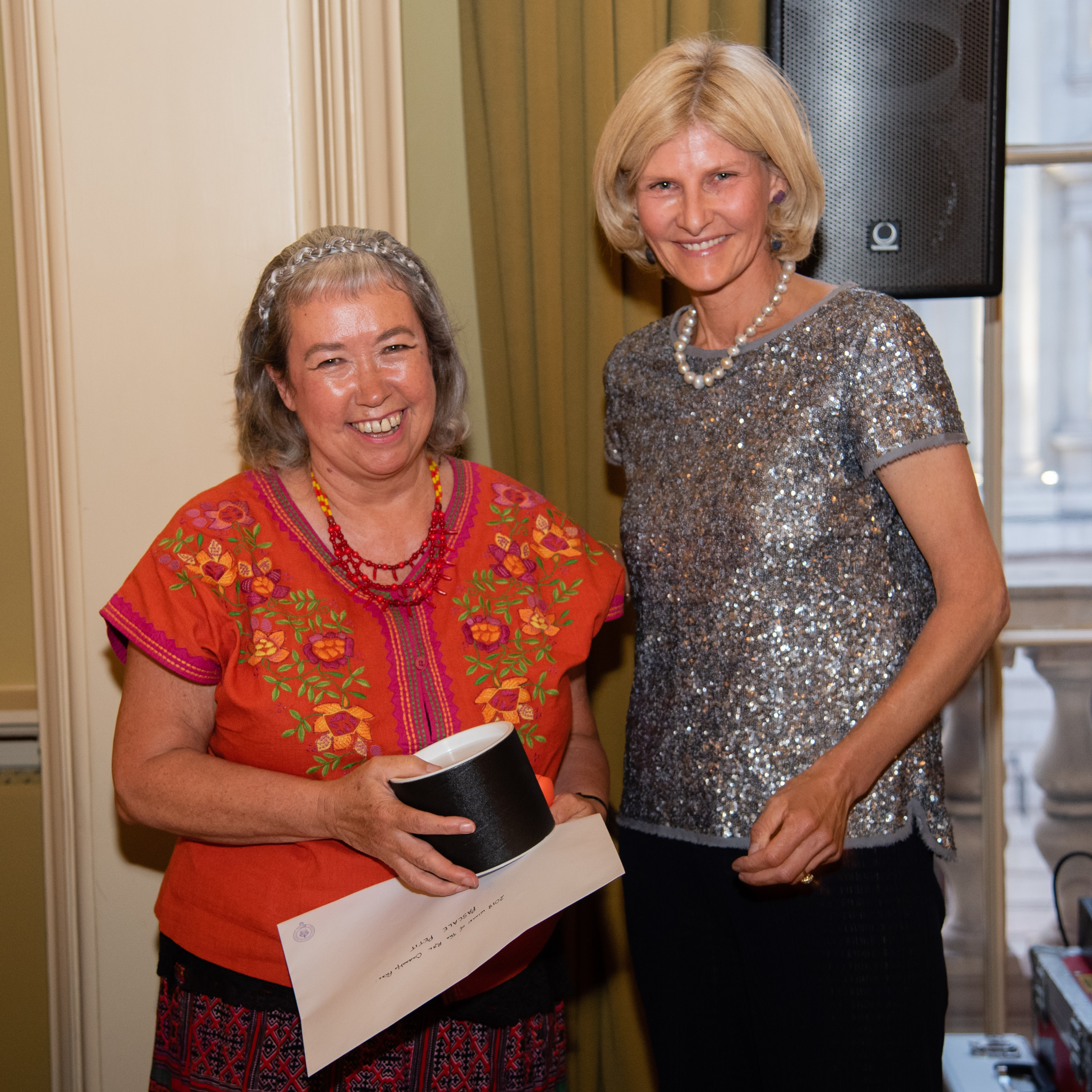 Pascale Petit, left, receives her award