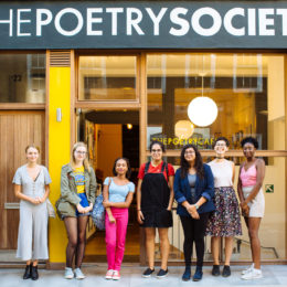 poets stand in front of the poetry society cafe