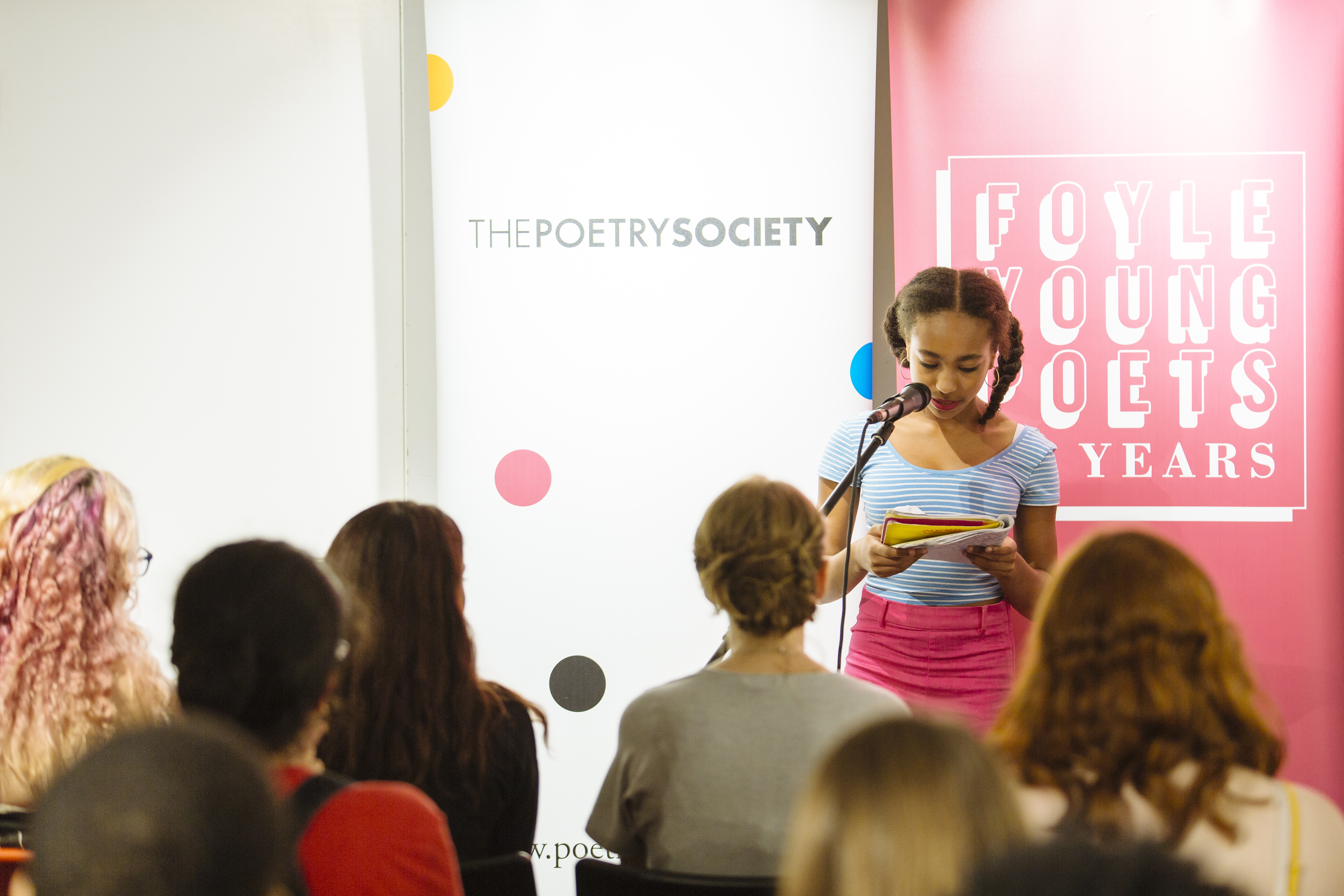 young poet reads before a crowd