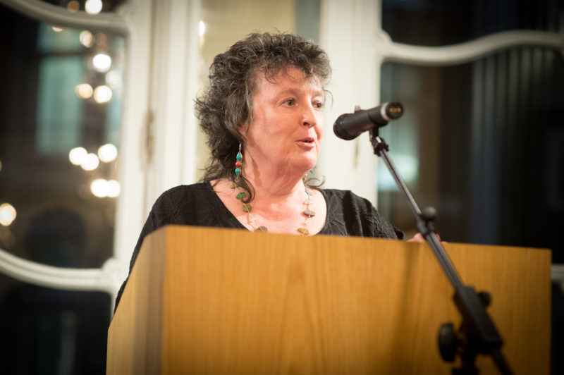 Carol Ann Duffy speaking at a podium
