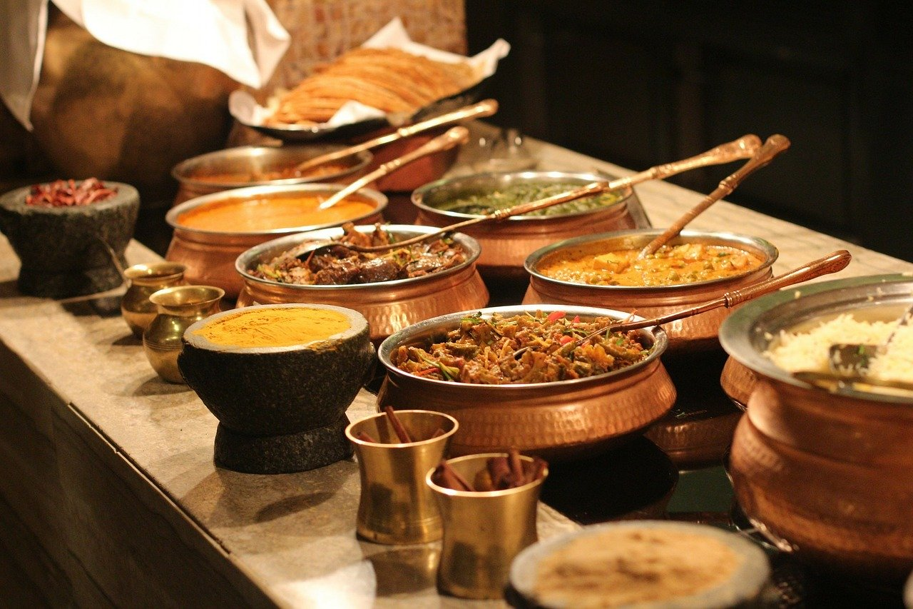 Photo of a table of different Indian dishes