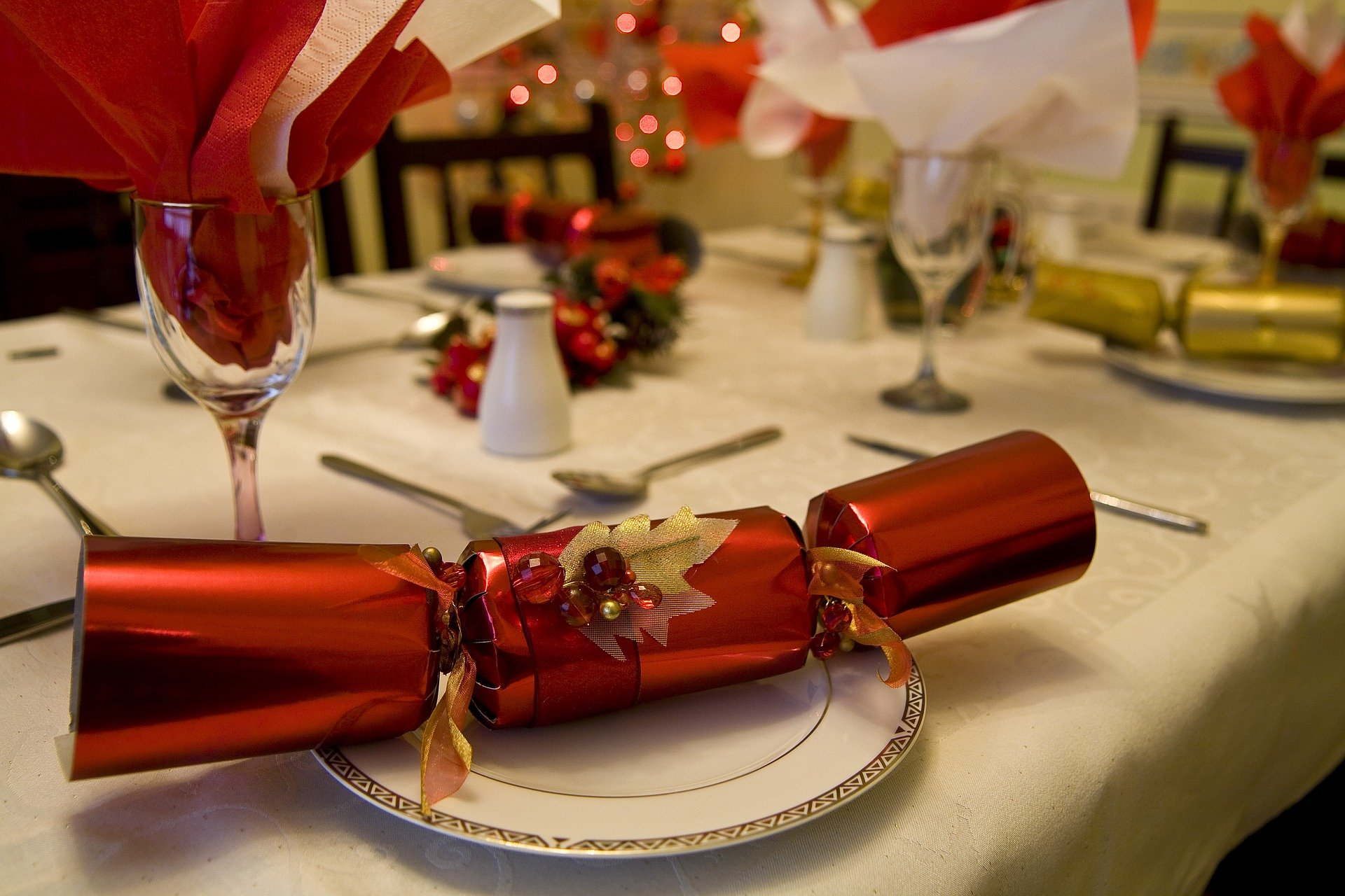 Red Christmas cracker on a plate