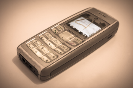 Silver Nokia phone with a cracked screen