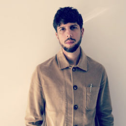portait of poet in beige shirt with large buttons