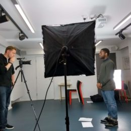 Dipo Baruwa-Etti being filmed to camera at The Poetry Café in 2018 as part of his End Hunger UK challenge prize.