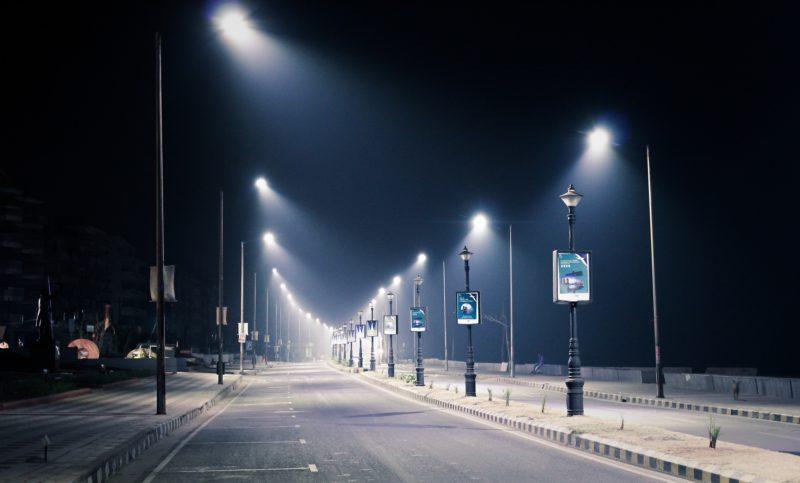streetlights shining on a road