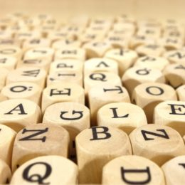scattered wooden letter beads