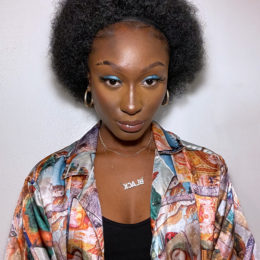 Briancia Mullings, wearing a multicoloured shirt over a black top