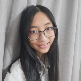Ran Zhao, wearing glasses and a white fleece